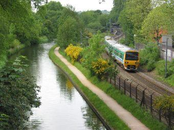 Class 323 electric multiple unit train, running along Worcester and Birmingham Canal